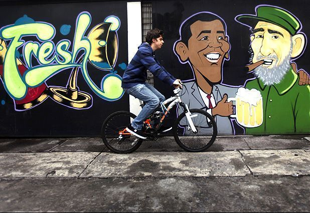 Obama and Fidel Castro graffiti  A man cycles past a wall graffiti of caricatures of U.S. President Barack Obama (L) and Cuban leader Fidel Castro outside a restaurant in Mexico City. #cubanleader Obama and Fidel Castro graffiti  A man cycles past a wall graffiti of caricatures of U.S. President Barack Obama (L) and Cuban leader Fidel Castro outside a restaurant in Mexico City. #cubanleader Obama and Fidel Castro graffiti  A man cycles past a wall graffiti of caricatures of U.S. President Barack #cubanleader