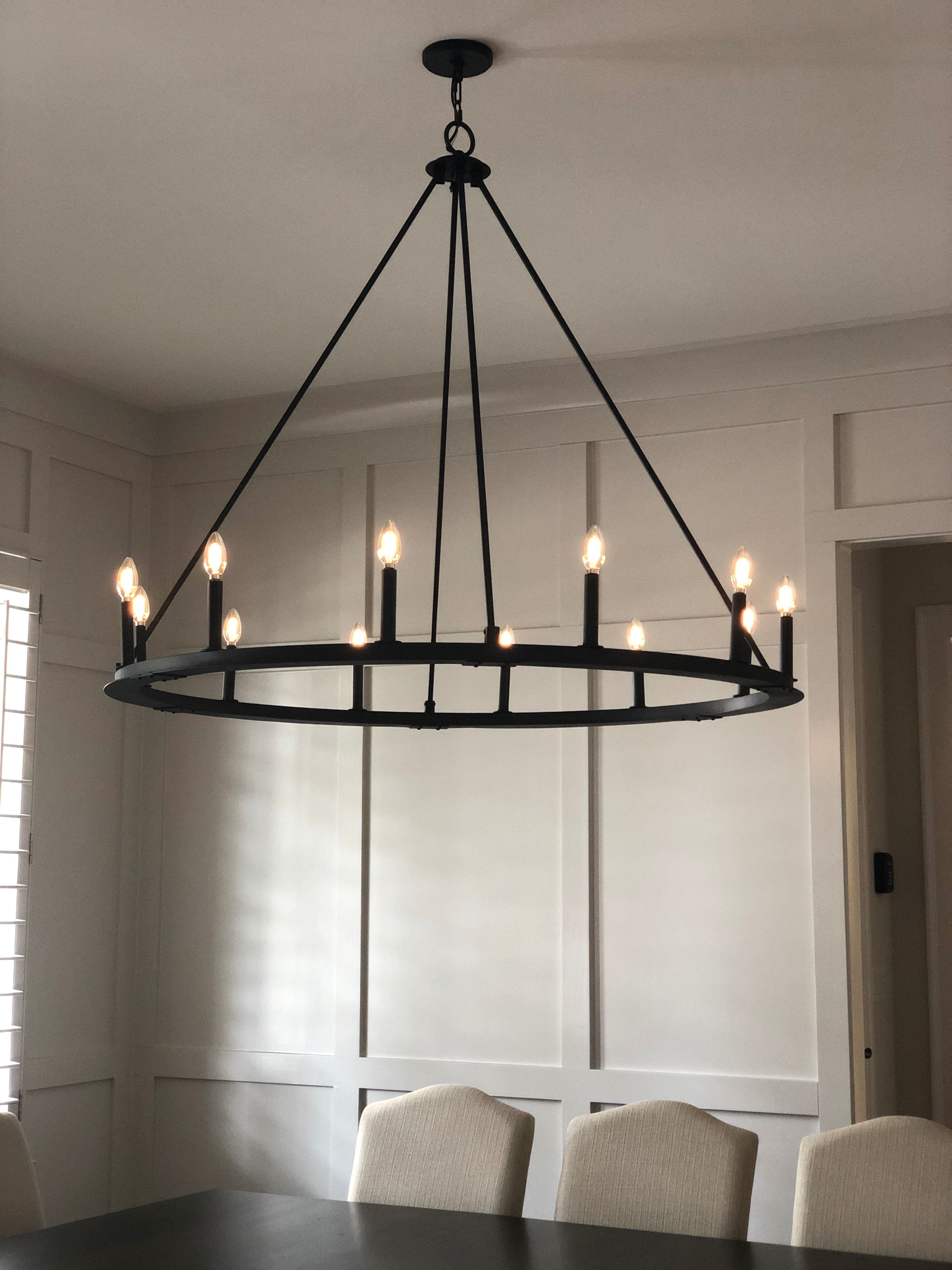This Dining Room Light Fixture Hangs Over A Massive 12 Person