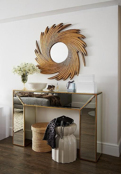 Chic Foyer Features A Gold Mirrored Waterfall Console