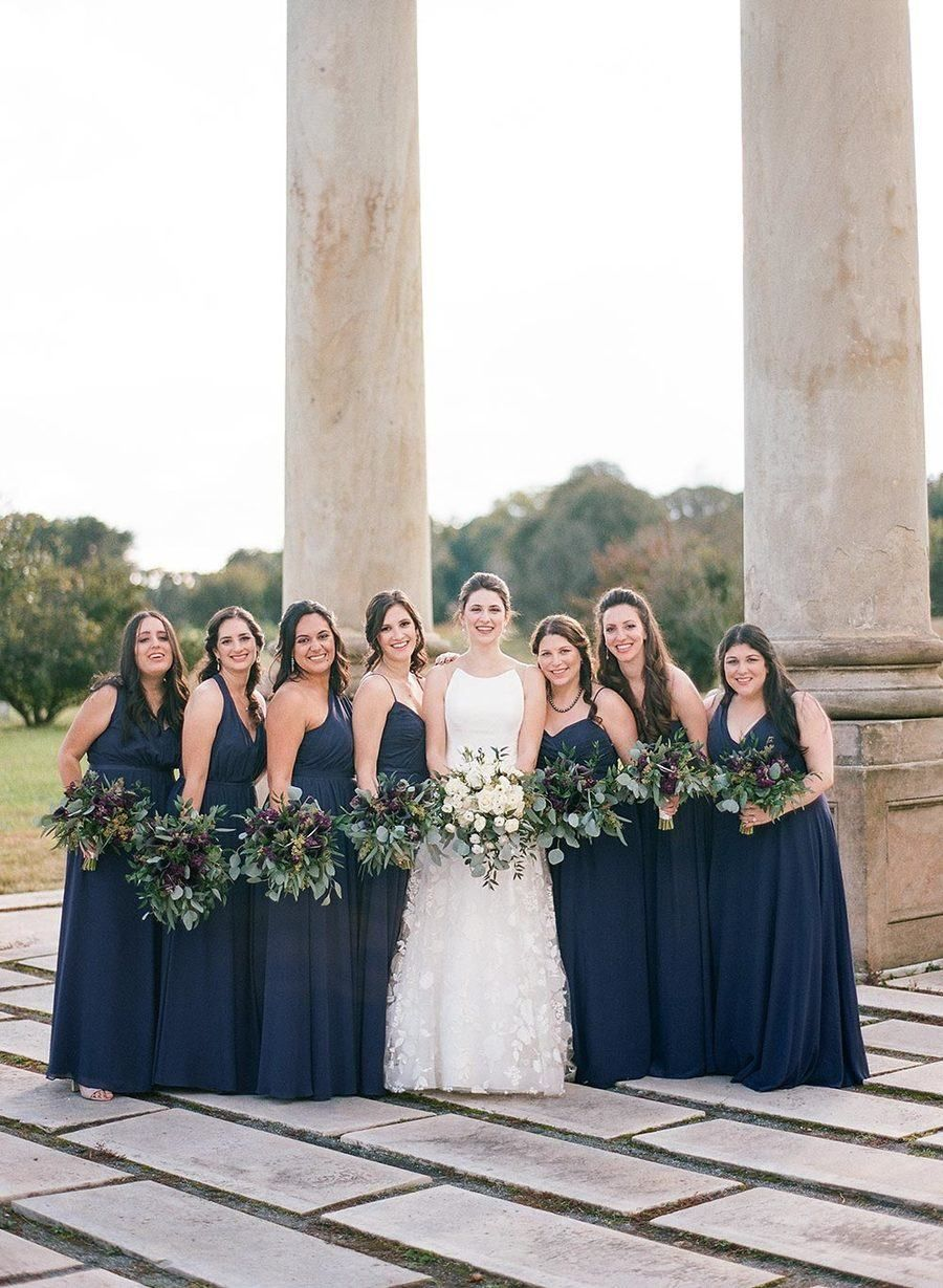 5ed397df0ea4 A favorite color of the bride, purple is used throughout the wedding from  the bridesmaid dresses to the wedding cake ...