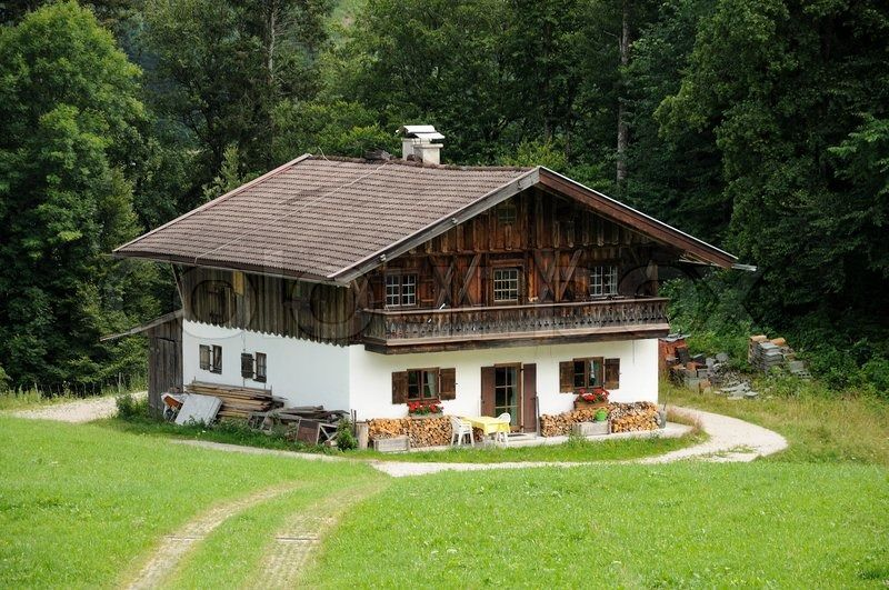 stock image of 'wooden house in the german alps' | alpen tirol