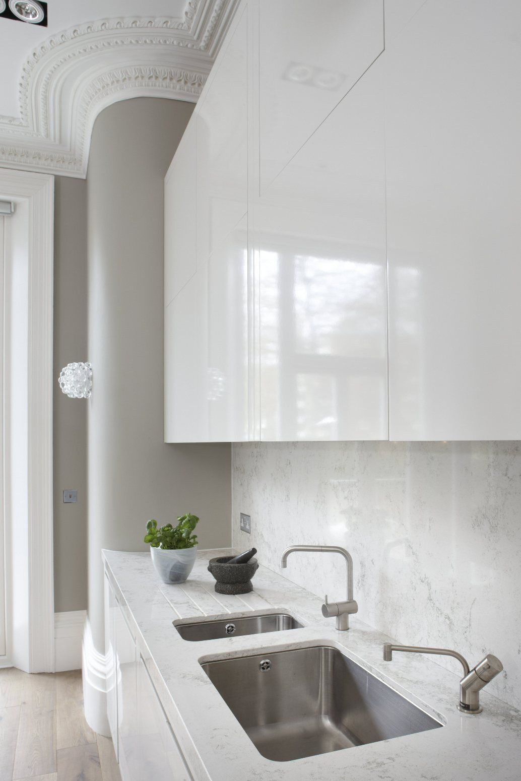 White Lacquered cabinetry built to the proportions of this