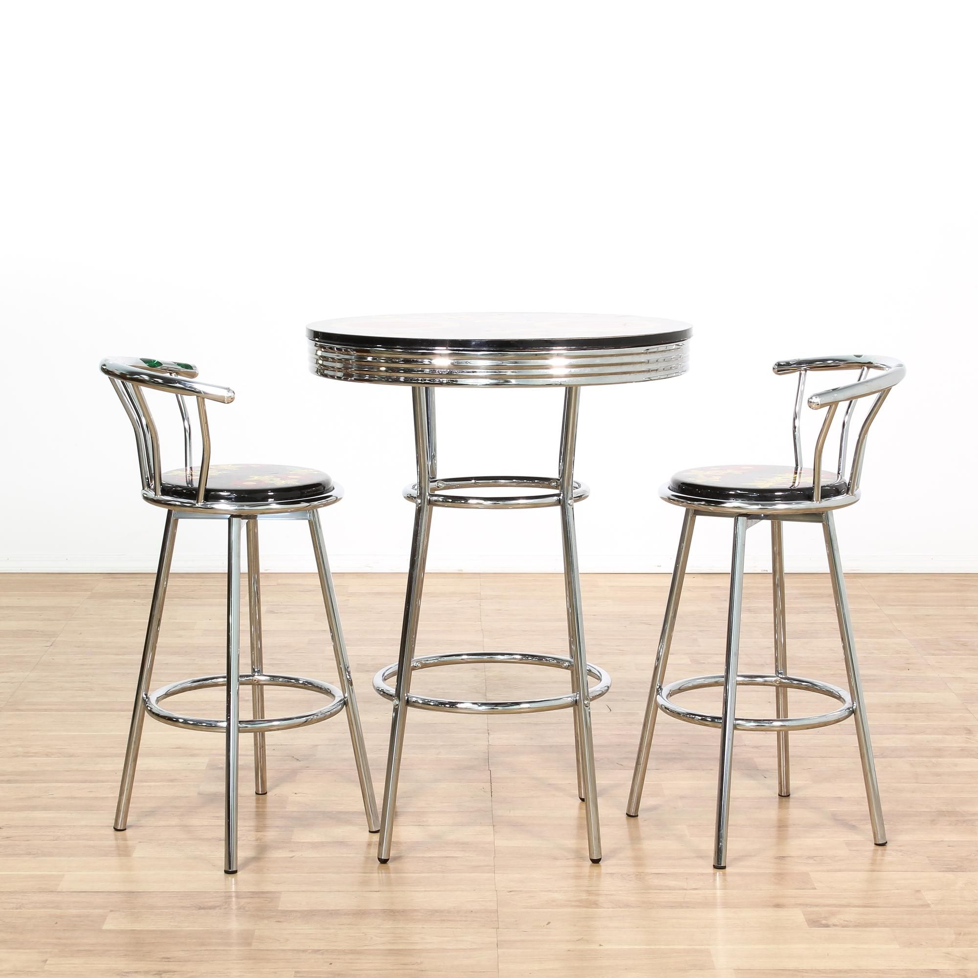 this cafe table set is featured in a shiny polished chrome this bohemian dining