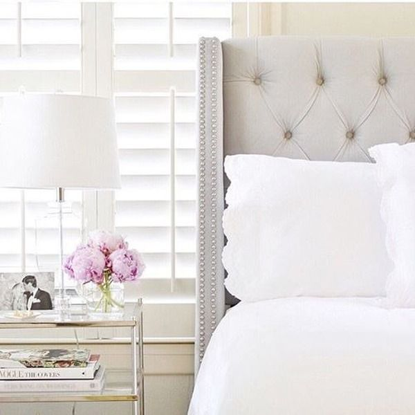 a tufted wingback headboard is a classic bedroom piece that will never go out of style