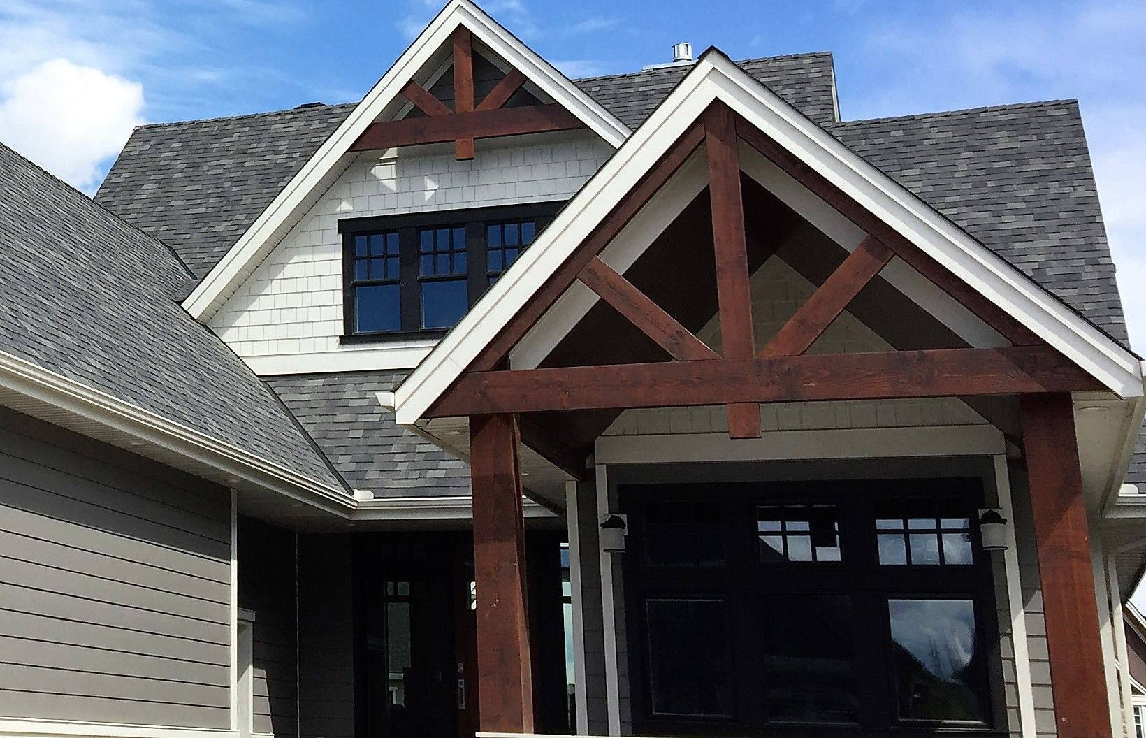 Timber Frame Trusses In Open Gable And Front Porch Roof. #