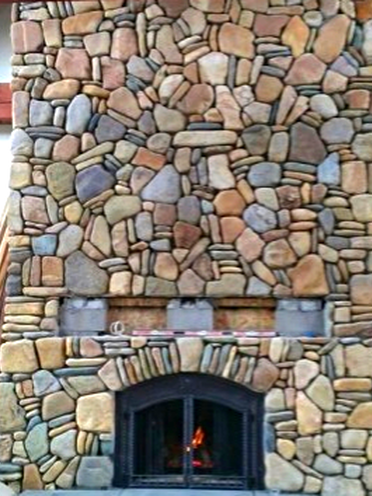 Madison Fireplace With River Rock In Whitefish Mt Installation And Masonry By Grizzly Fireplace Missoula Montana Indoor Fireplace Montana Design Fireplace