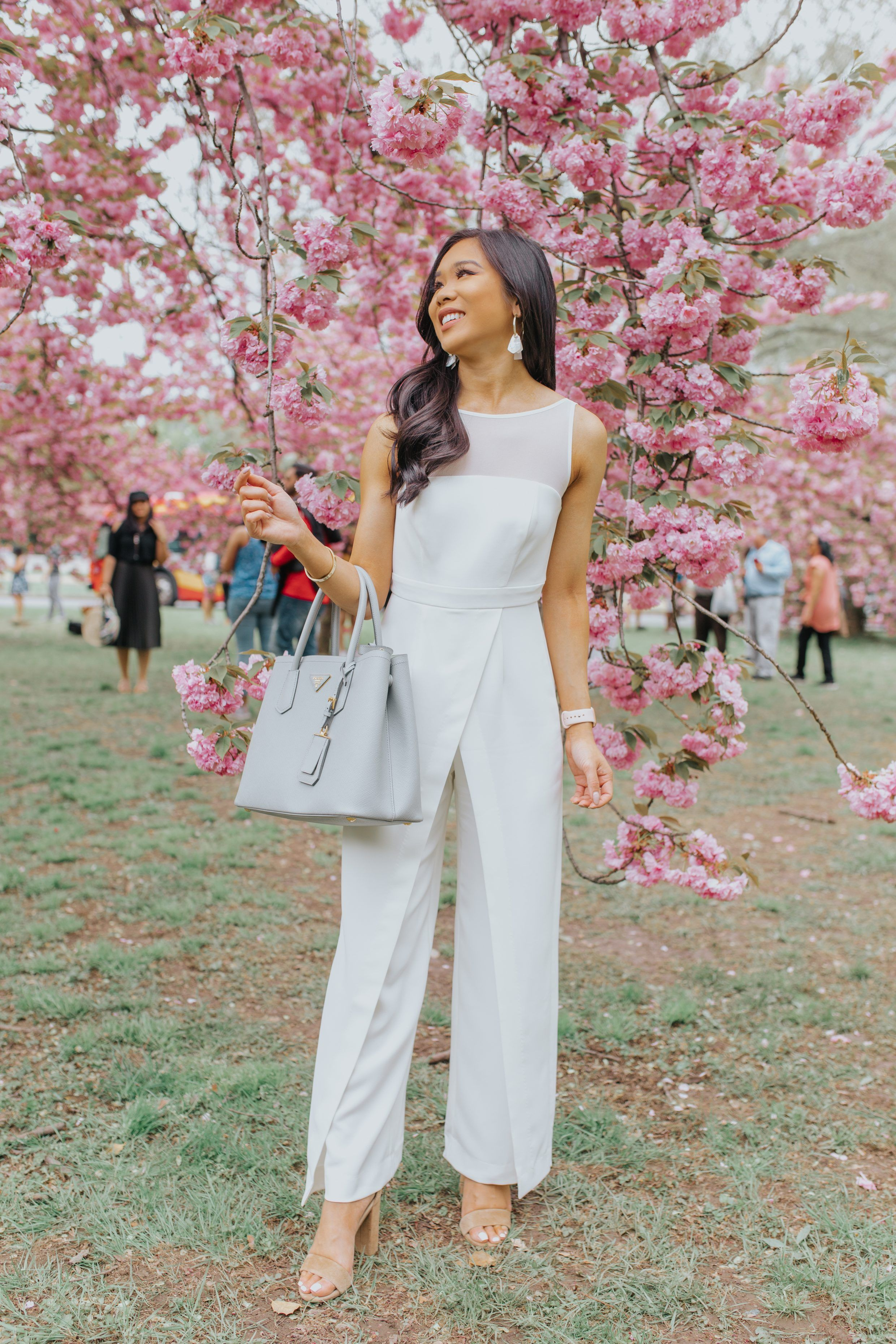 b73e09b7c Hoang-Kim wears a white statement jumpsuit amidst the cherry blossoms in  Washington, D.C.