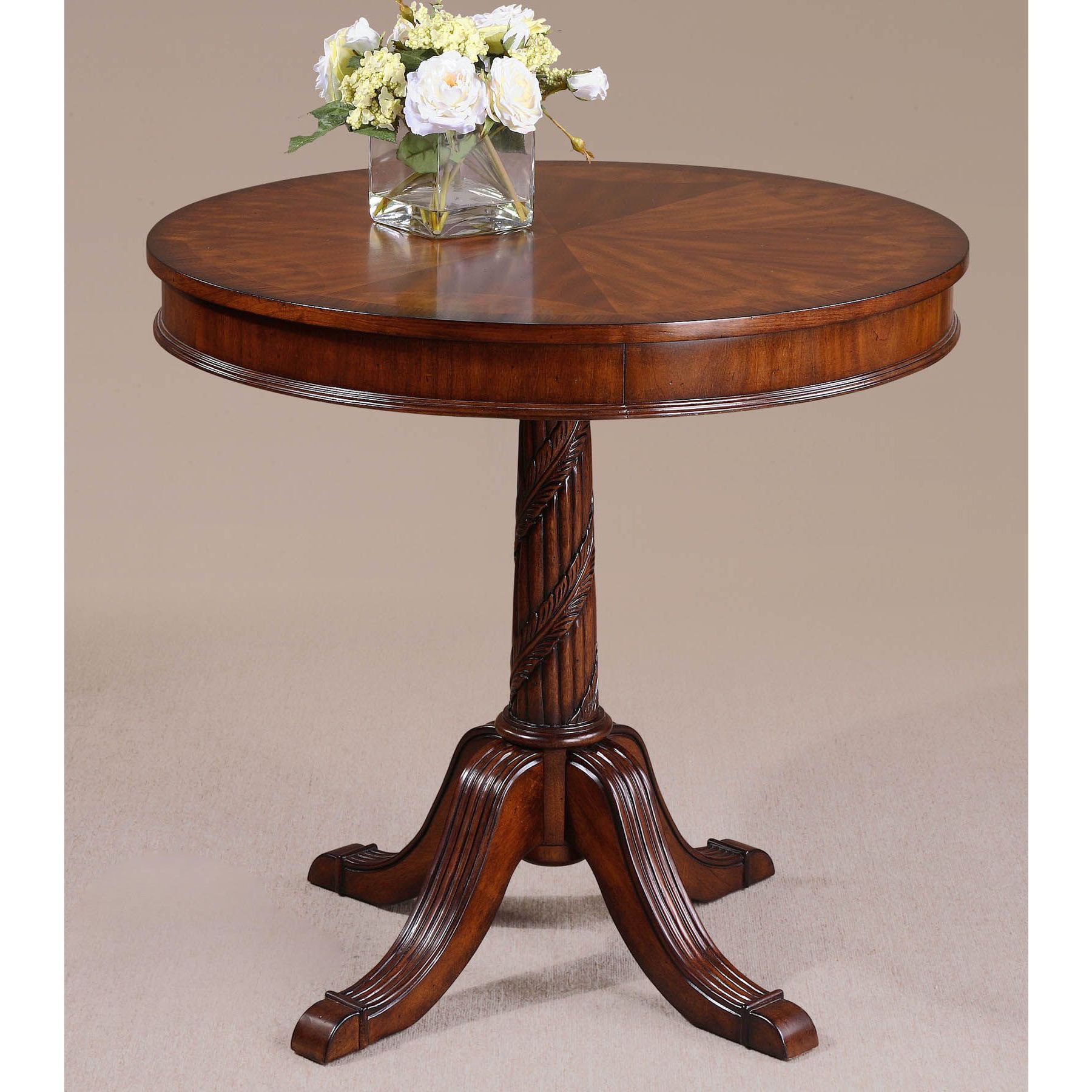 The brakefield table features an elegant polished pecan finish over