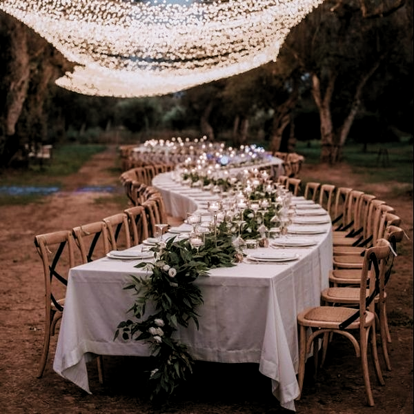 Romantic Lighting over Table Setting  #outdoorwedding #tablescapes #tabledecor