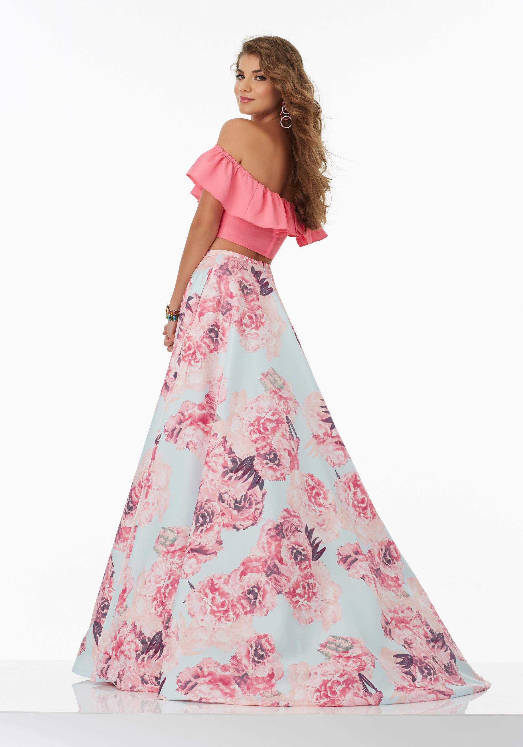 876e26cca68 Prom Dresses by Morilee designed by Madeline Gardner. Fun and flirty Two-Piece  Prom Dress with Off-the-Shoulder Ruffled Neckline and Floral Taffeta Skirt.