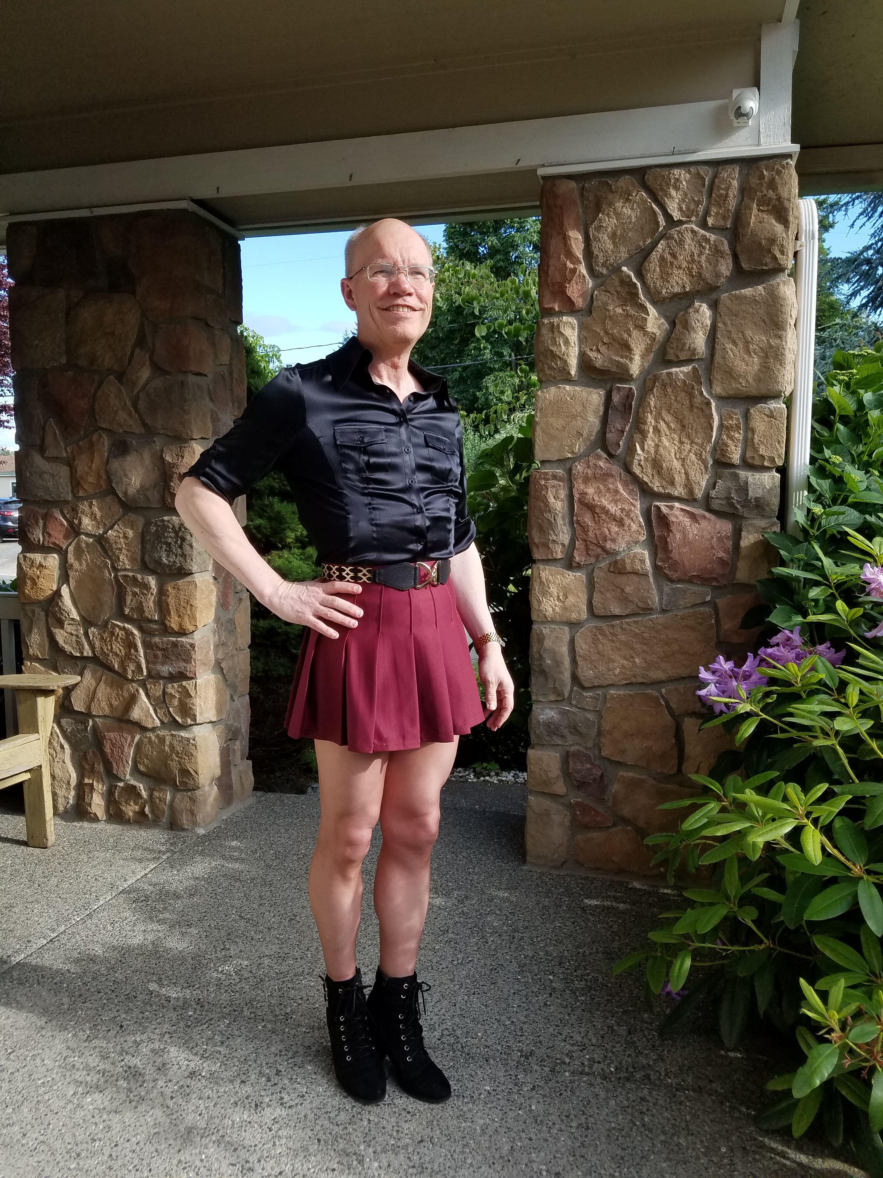 Black satin silk shirt, pleated maroon tennis skirt