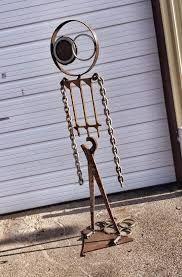 Image result for scrap steel garden art