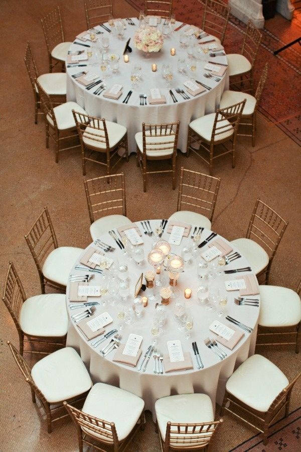 Centerpieces For Round Tables With White Tablecloth And Some Cream