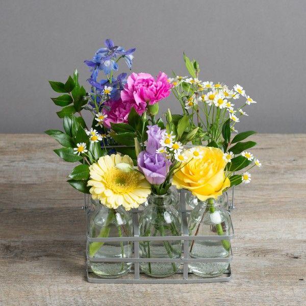 Flower bottles bright cheery vintage bottles flower for Flowers in glass bottles