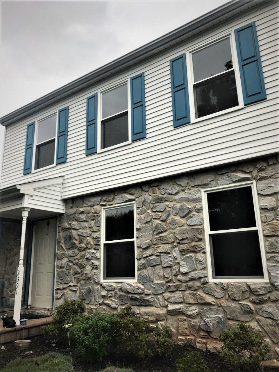 Installing Marvin Infinity Double Hung Windows With White Exterior On Home In Warrington Pa Fiberglass Windows Patio Door Installation Window Vinyl