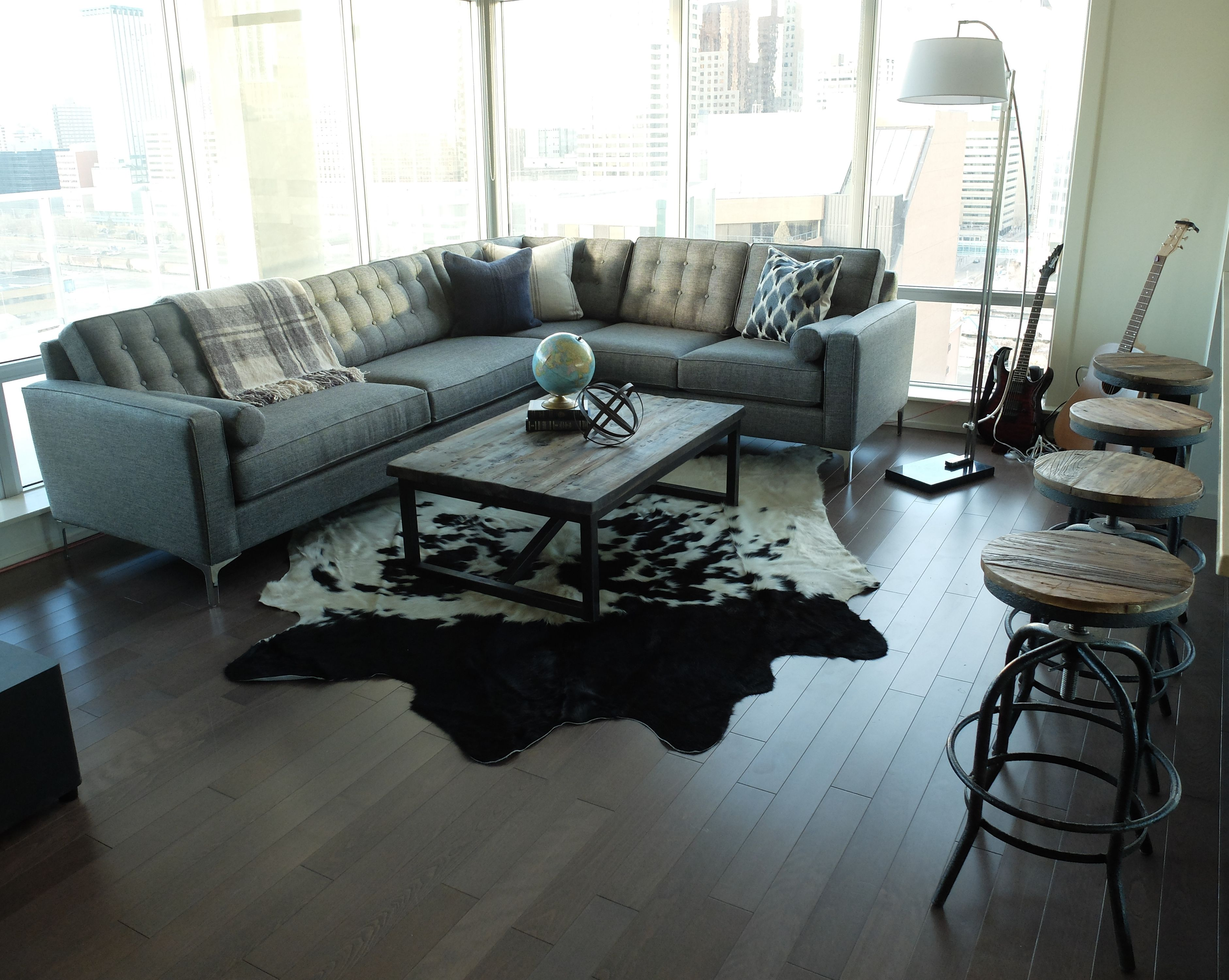 Condo Living Room With Reclaimed Wood Coffee Table, Tufted Gray Sectional,  Black And White
