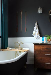black bathroom with copper accessories