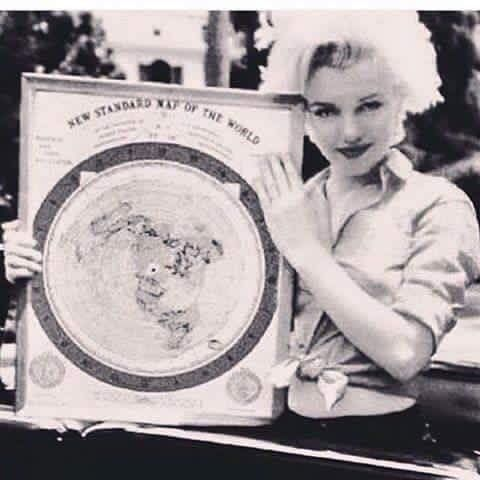 Marylin Monroe with Flat Earth map.I think powerful men would