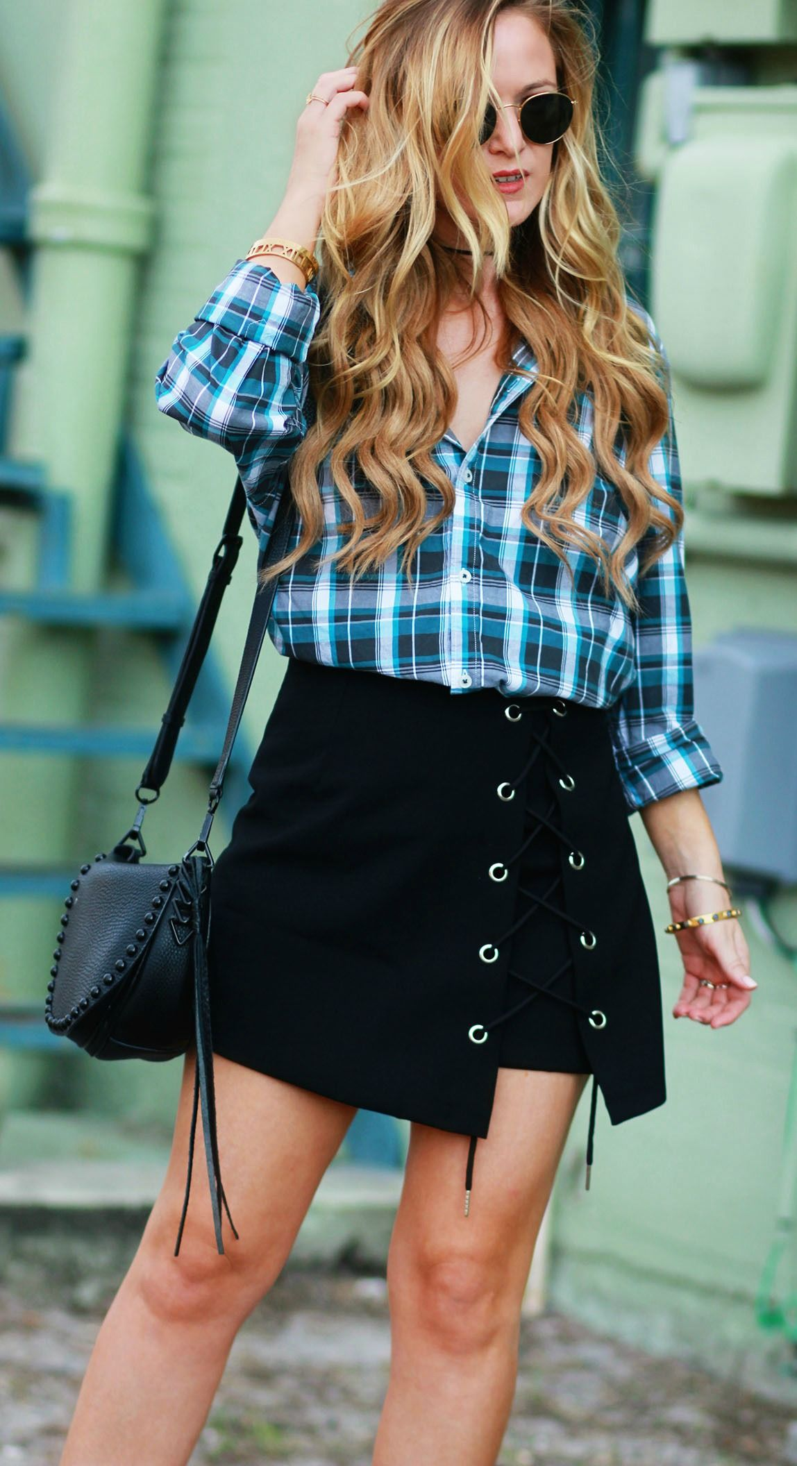 c11ee54be Fall transition outfit styled with a boyfriend plaid shirt, lace up mini  skirt, block heel sandals, Rebecca Minkoff saddle bag, and round Ray Ban  sunglasses