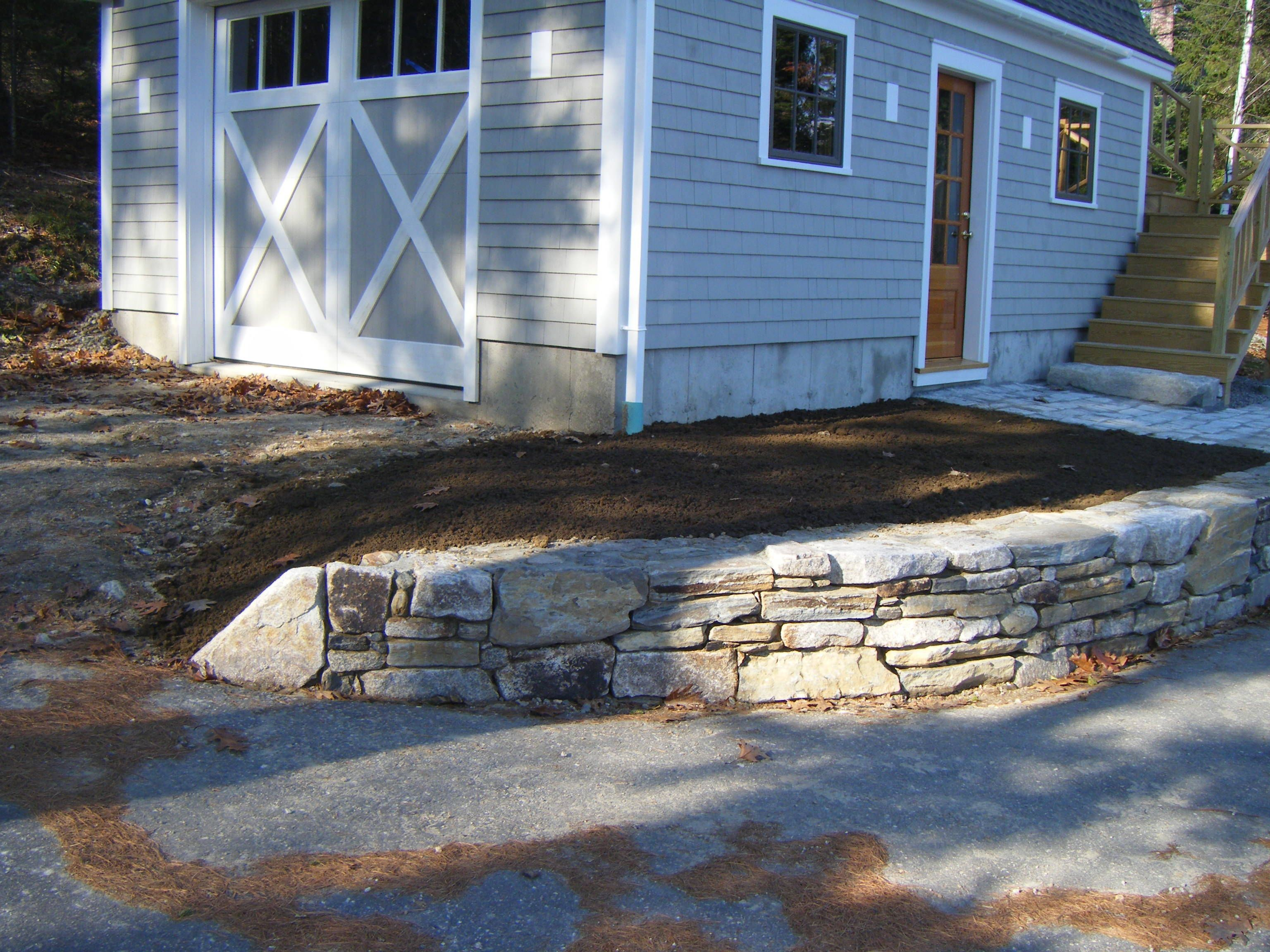 Front yard stone wall example with images yard stones