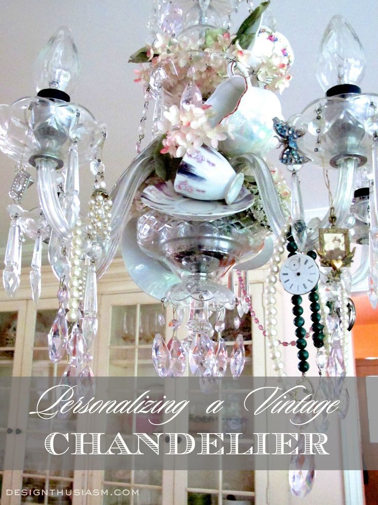 A VINTAGE CHANDELIER is completely transformed by adding teacups, personal items and decorating favorites. | Desigtnhusiasm.com #homedecor #frenchcountry