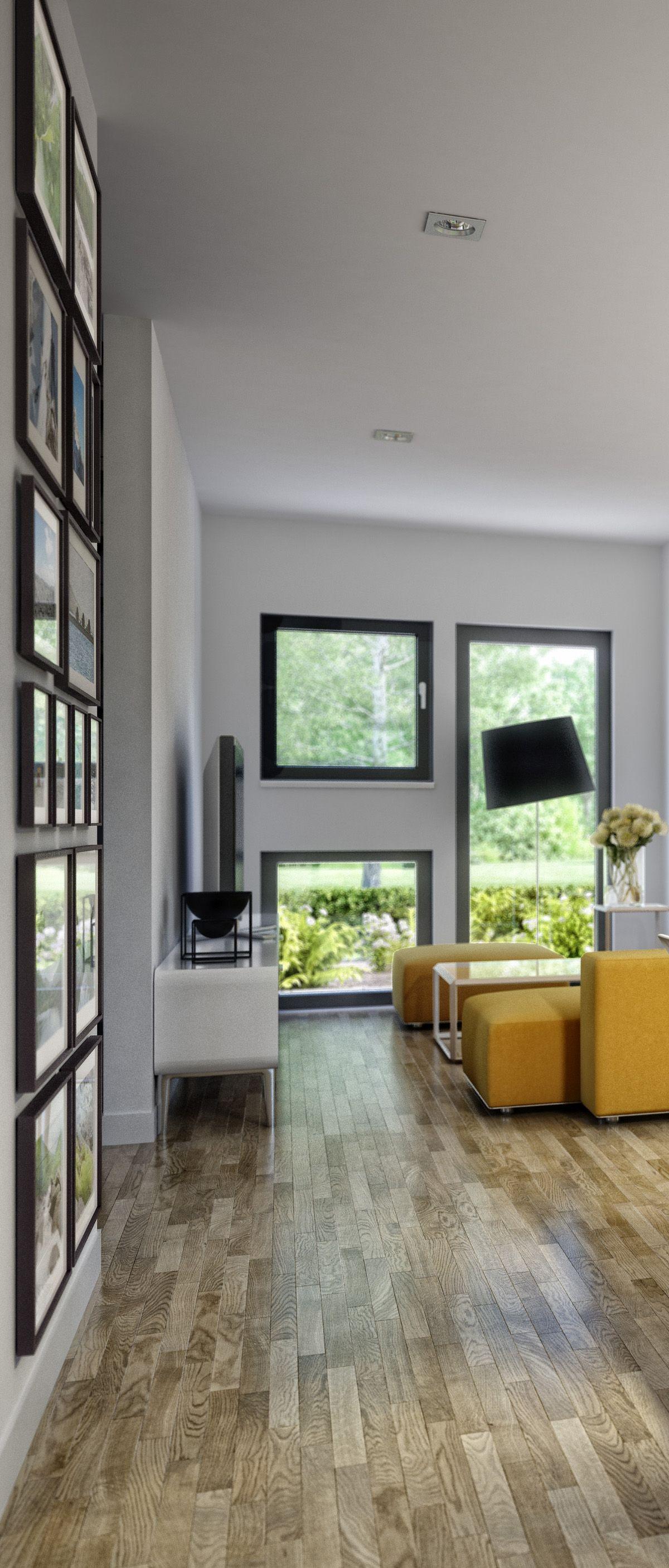 Knallige Couch und dunkle Fenster- und Bilderrahmen machen den Mix ...