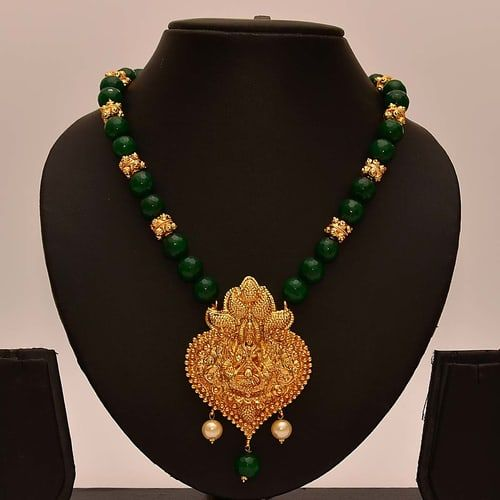 Buy Anvi\'s Lakshmi (temple Jewellery) Pendent With Emeralds And Gold Beads online. ✯ 100% authentic products, ✯ Hand curated, ✯ Timely delivery, ✯ Craftsvilla assured.