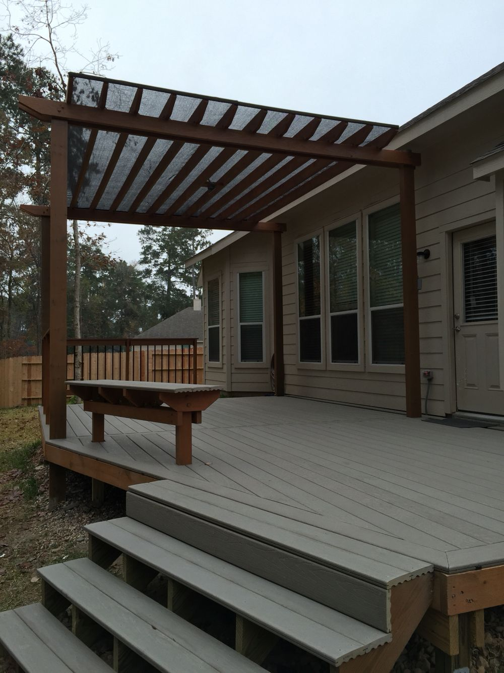 Pergola deck topped with composite decking. No staining or ...