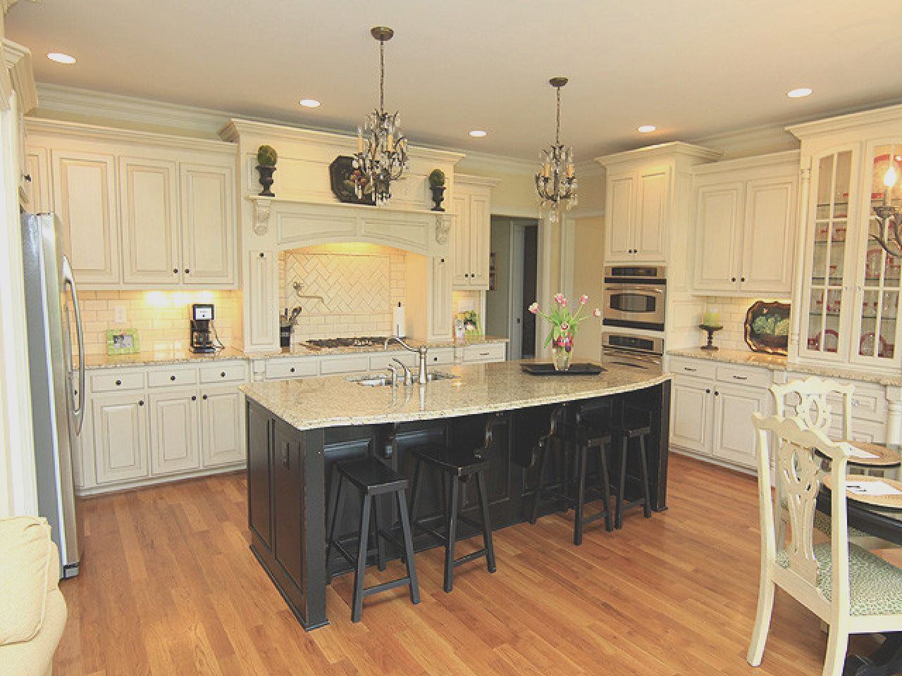 Image Result For Cream Kitchens With Black Island Images French Country Kitchen Cabinets Country Kitchen Cabinets Country Kitchen Designs