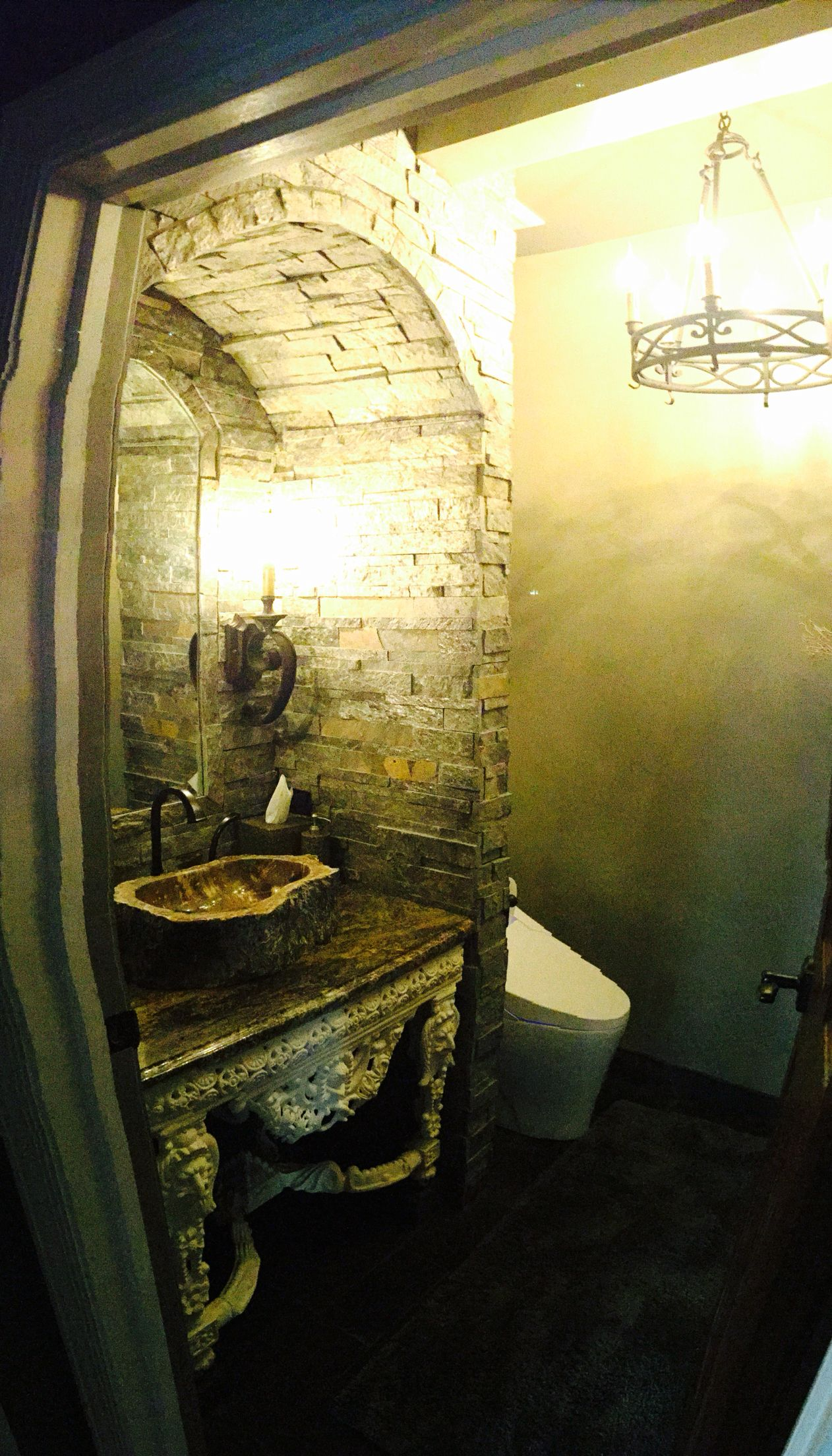 Medieval old world castle bathroom with stone surround and