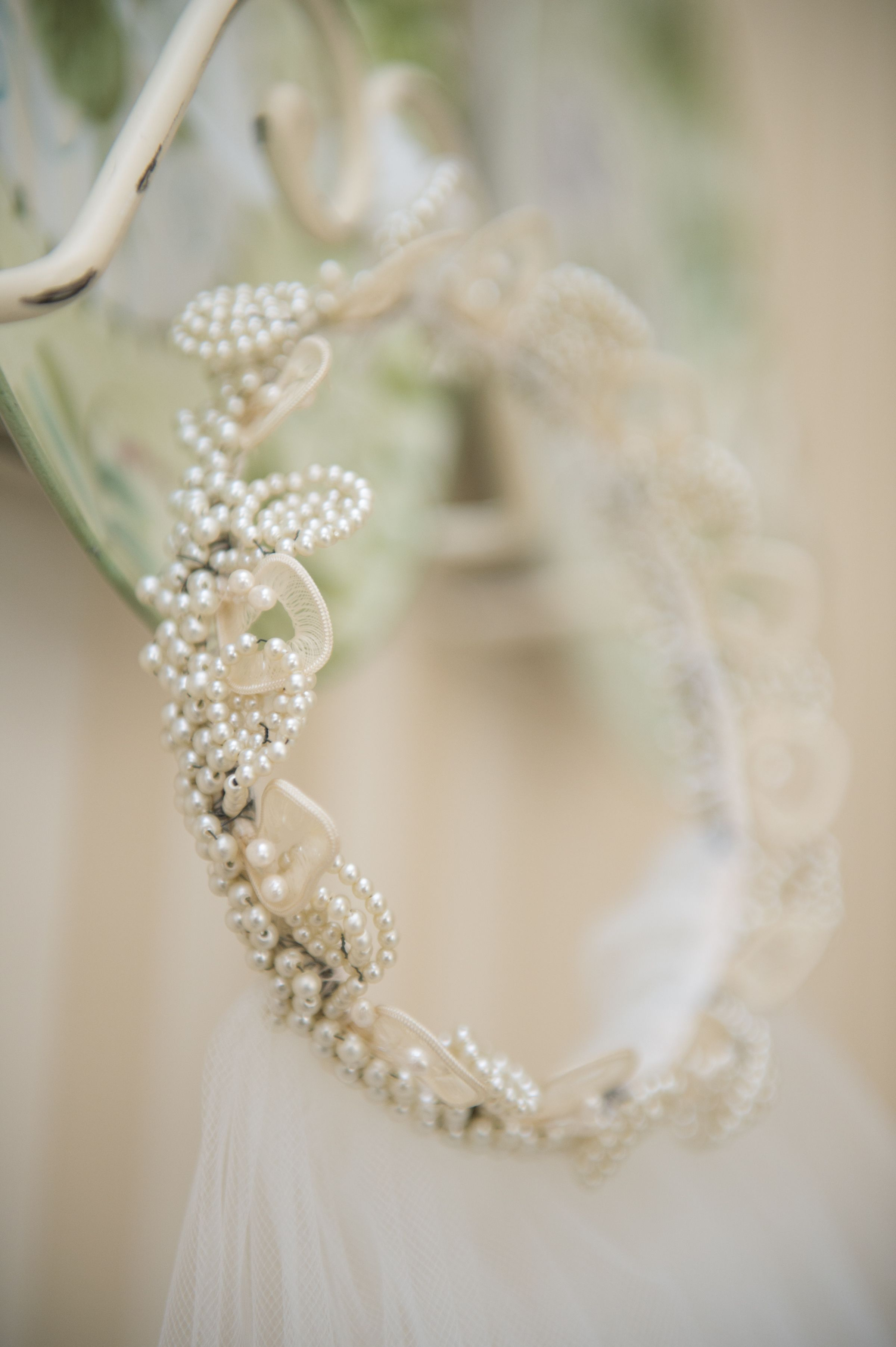 Vintage veil. The bridal crown has been in three  generations of weddings. First worn by the bride's grandparents who were married for fifty five years, and then by the bride's mother, who has been happily married for thirty five years. A good luck charm? Perhaps.
