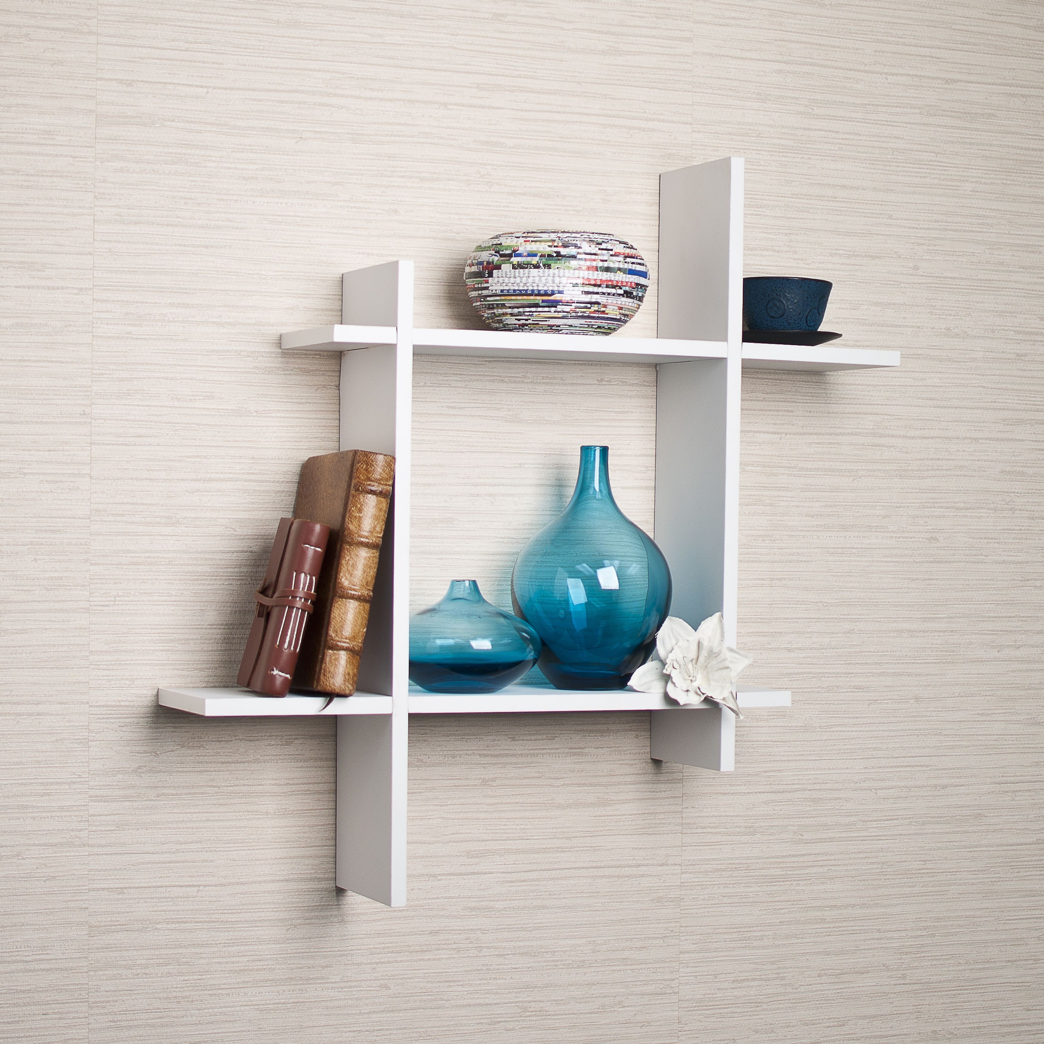 Decorative Wall Shelf Shows 4 Asymmetric Sides To A Square Which Intersect And Connect With Each Other Made Of Laminated Mdf It Attaches The