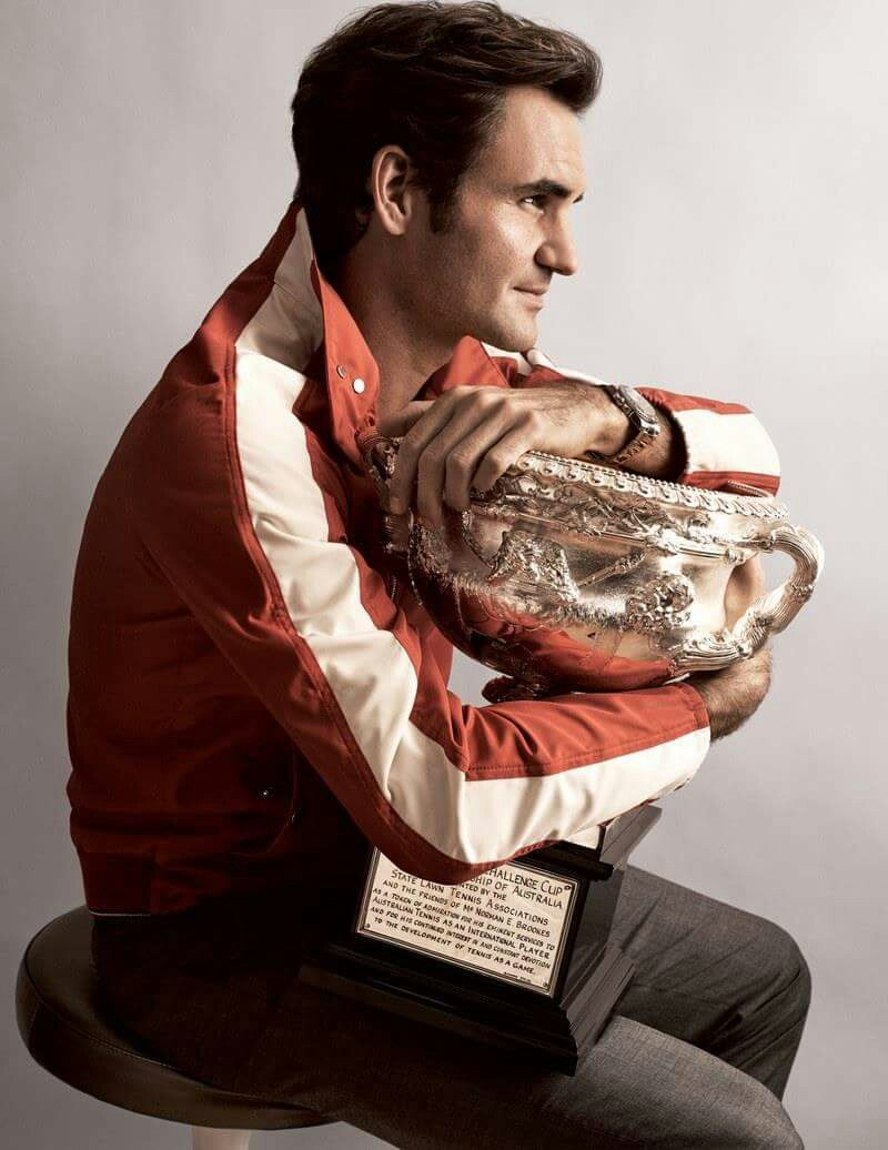 Roger Federer holds the Norman Brookes Challenge Cup tightly after