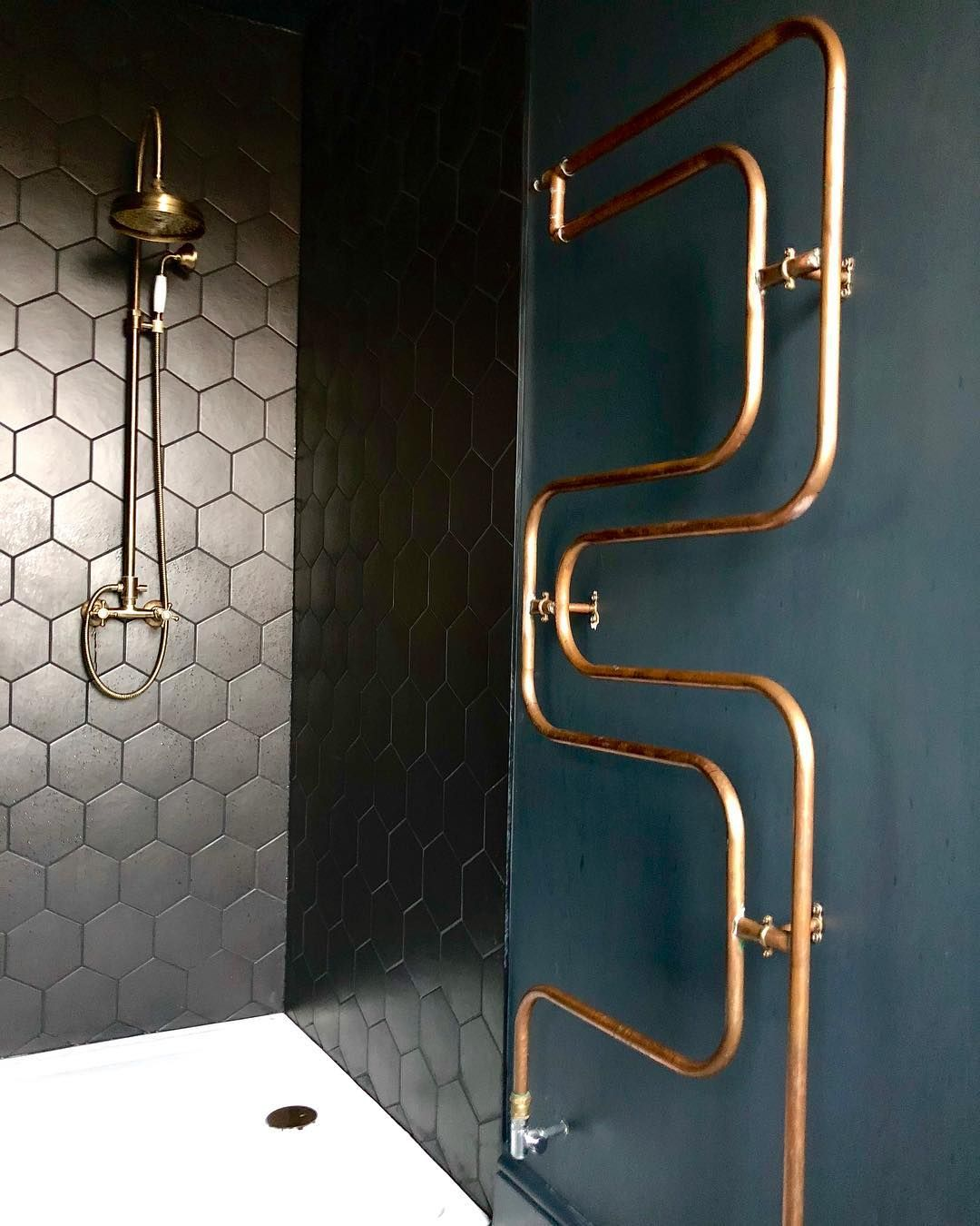 """Photo of Suszi Saunders on Instagram: """"A detail shot for you guys this morning. This lovely brass shower is by @bespoketaps and the copper pipe radiator was made by our amazing…"""""""