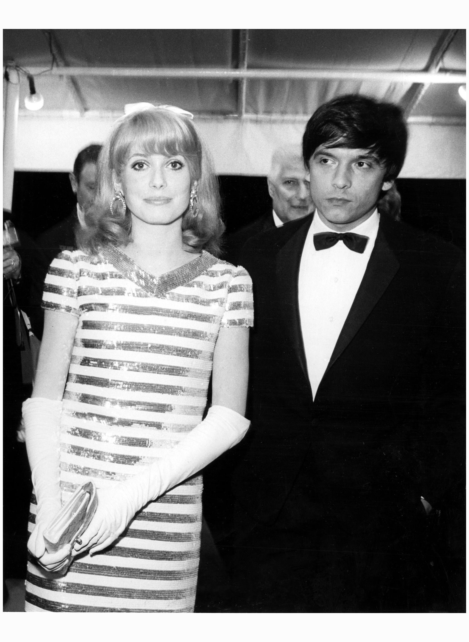 Photographer David Bailey with Catherine Deneuve at the Cannes Film Festival in 1966.