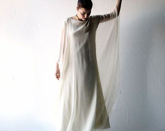 A unique wedding dress. It has a strange, ethereal lightness, and a timeless shape, reminiscent of celtic priestesses, of floating greek goddesses, long silk gowns blowing in the wind.  It is composed of two layers of silk fabric. The bottom layer is a silk crepe de chine I hand dyed using golden onions. The color is a lush, stunning golden. It is cut in a sleek a-line shape.  The top layer is a sheer crepe chiffon, light, breezy, flowing and loose. The two layers are connected only at the…
