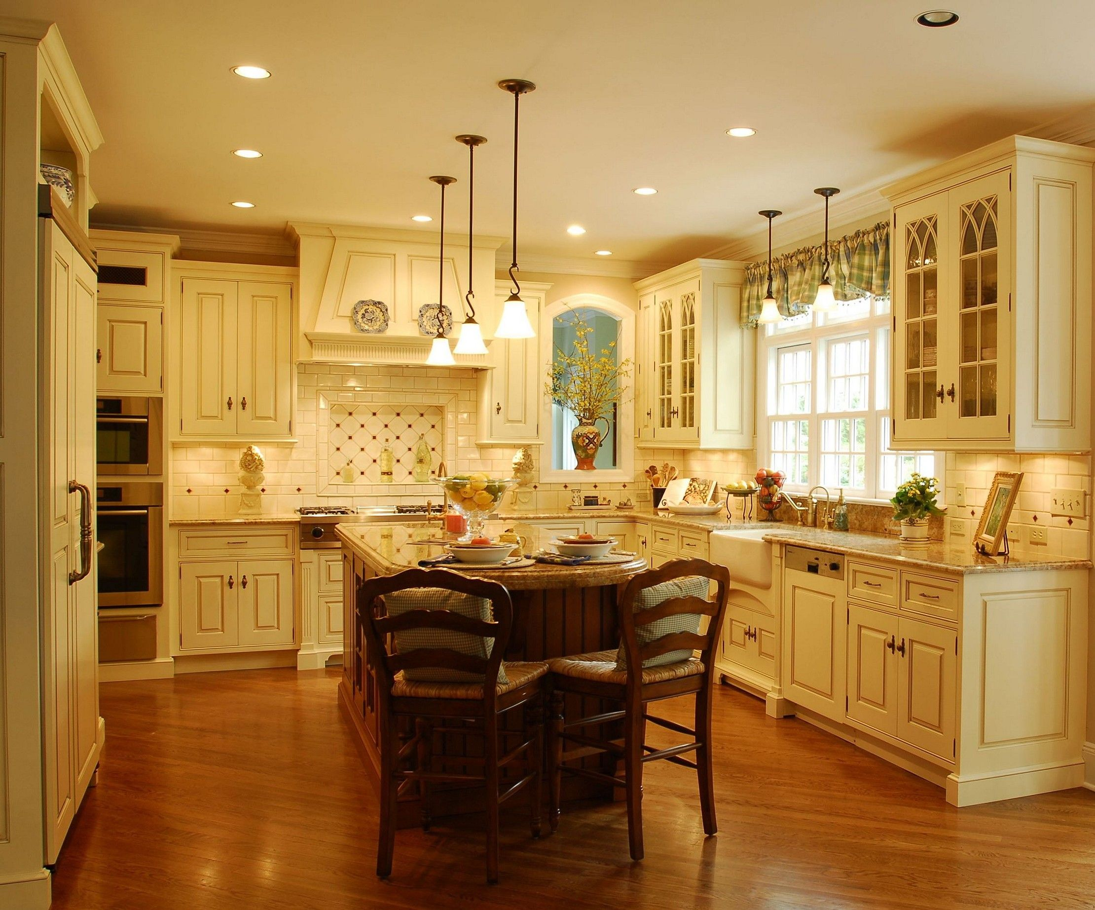 Image result for cream colored kitchen cabinets with dark island ...