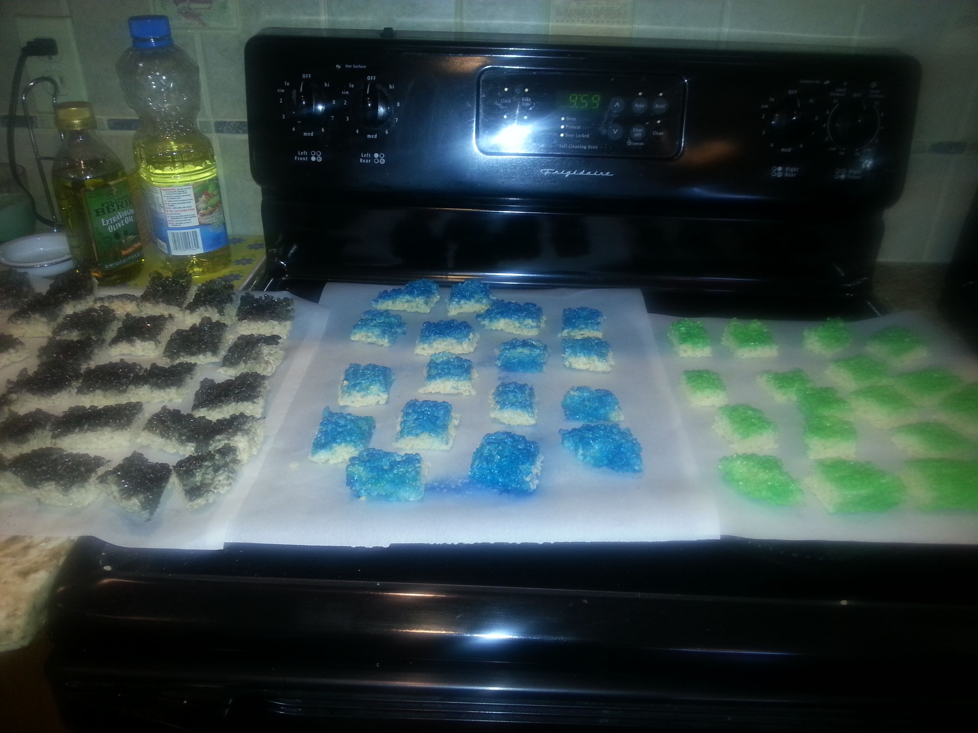Rice krispy treats decorated with spray-on food coloring for water, grass, and coal.