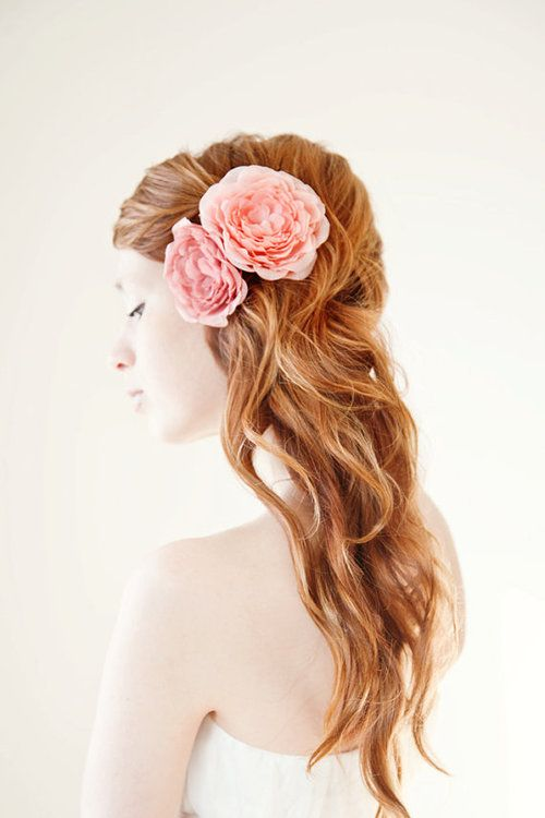 Bridal hair style. Red head. Pink flower hair accessories. Tousled.