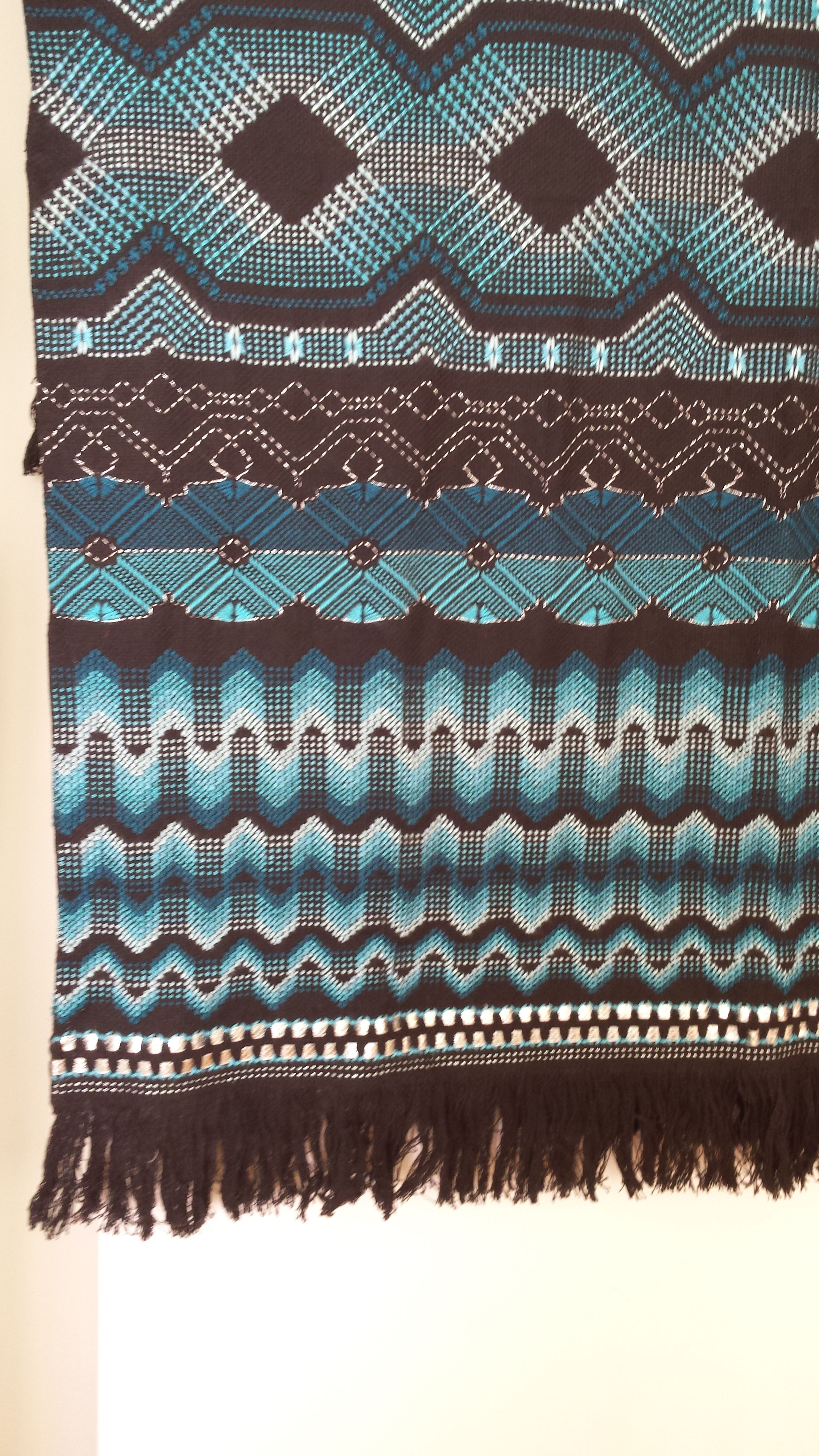swedish weaving on black cloth withe shades of turquoise and silver ...
