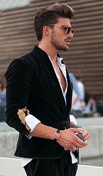 mens fashion Pompadour hair style, five o-clock shadow, eye glasses, watch, open button down shirt, embroidered sleeve jacket... hallmarks of a playboy....