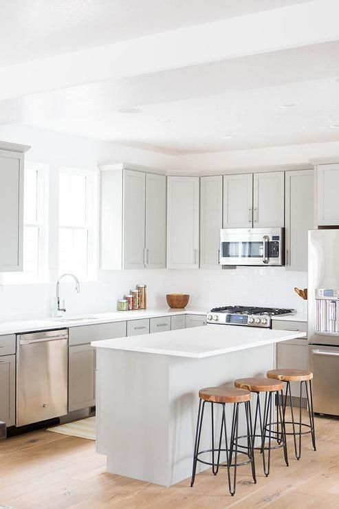 Fantastic Kitchen Features Light Grey Shaker Cabinets Paired With