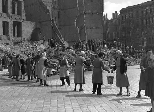 9th July 1945: Women in post-war Berlin, East Germany, form a 'chain gang' to pass pails of rubble to a rubble dump, to clear bombed areasimages of post war germany - Google Search