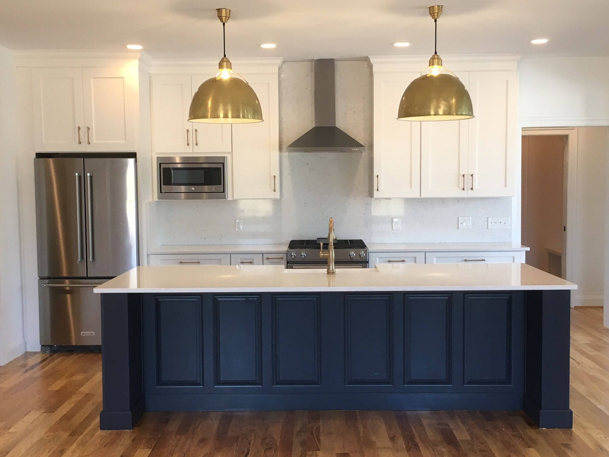 Mixed metals and navy island kitchen by JM Selections ...
