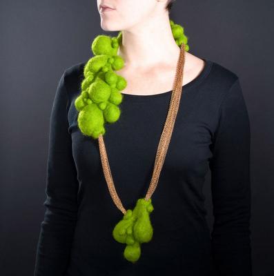 "Nikky Bergman –USA   ""Chlorophilious,"" wool felt, commercial brass chain  20""x3""x2"", 2007"