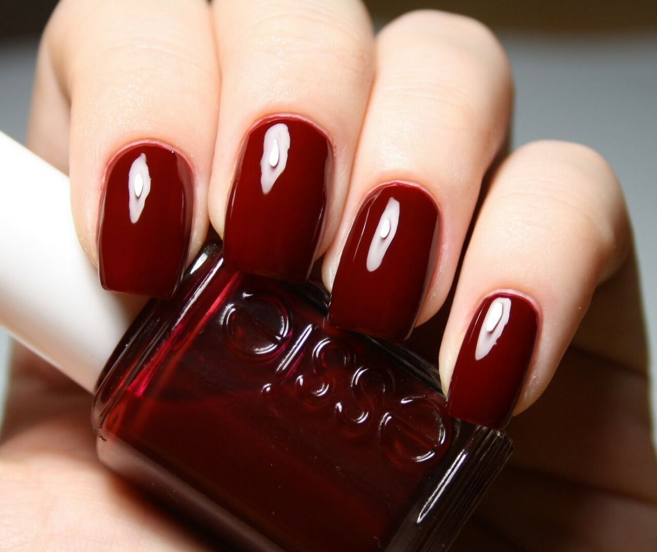 Essie burgundy dark red nail colour nail polish in \