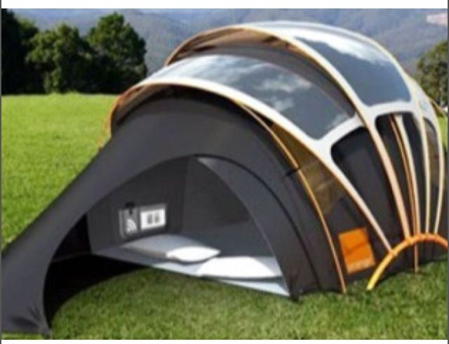 A tent w solar panels and a docking station......sweet....