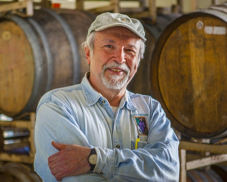 John wears many hats at Helvetia Winery, including tractor driver, tour guide and, of course, winemaker.