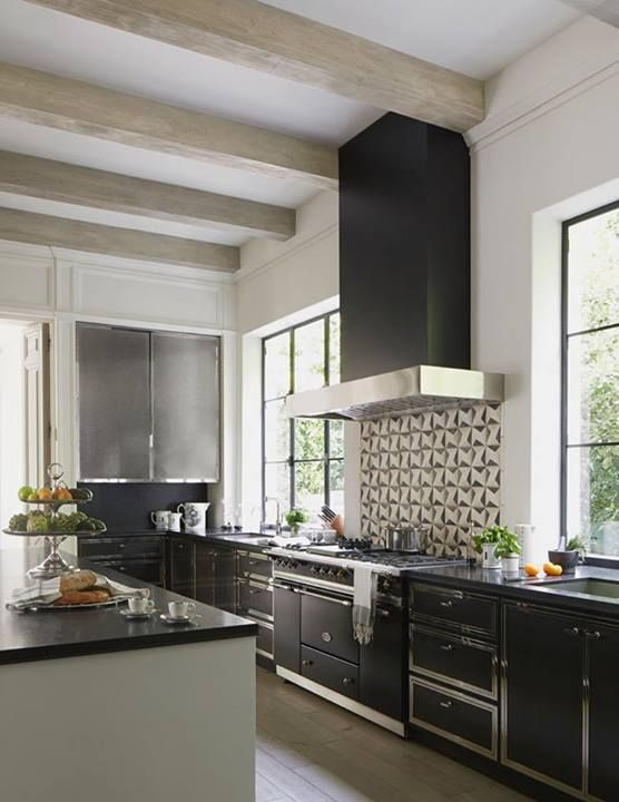 A graphic backsplash energizes the sleek black-and-white Kitchen of ...