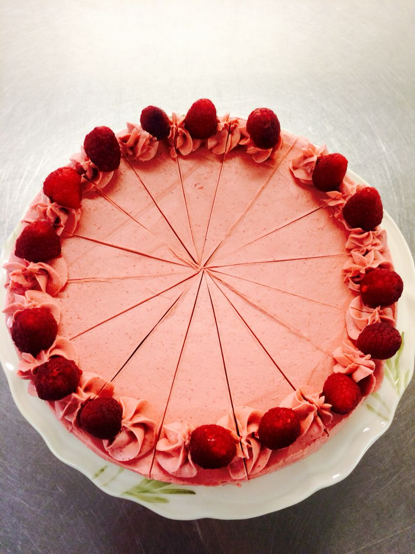 Golden almond cake with raspberry neoclassic buttercream